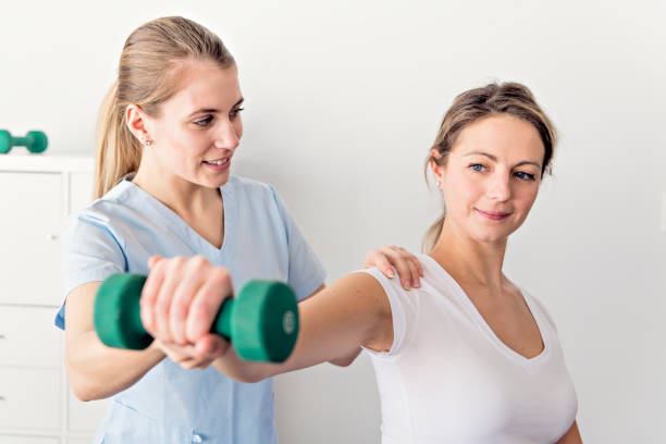 a modern rehabilitation physiotherapy in the room - sports medicine stock pictures, royalty-free photos & images