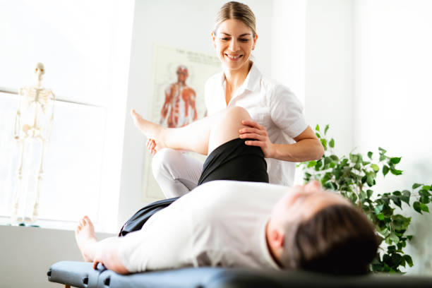 a modern rehabilitation physiotherapy woman worker with client - sports medicine stock pictures, royalty-free photos & images