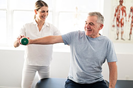 istock A Modern rehabilitation physiotherapy worker with senior client 1098314702