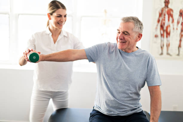 A Modern rehabilitation physiotherapy worker with senior client Modern rehabilitation physiotherapy worker with senior client recovery stock pictures, royalty-free photos & images