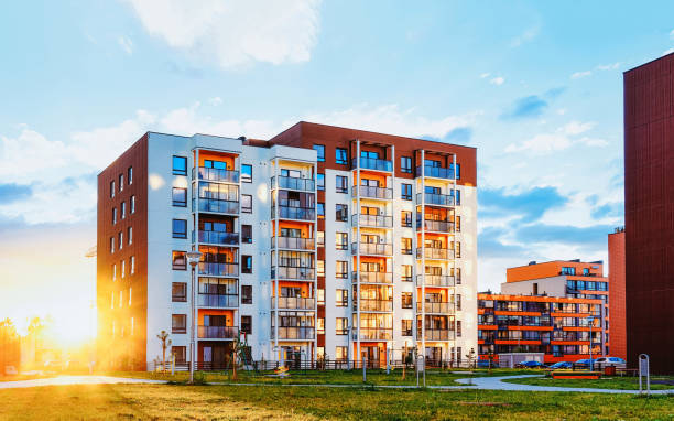 Modern residential apartments with flats building exterior and outdoor facilities stock photo