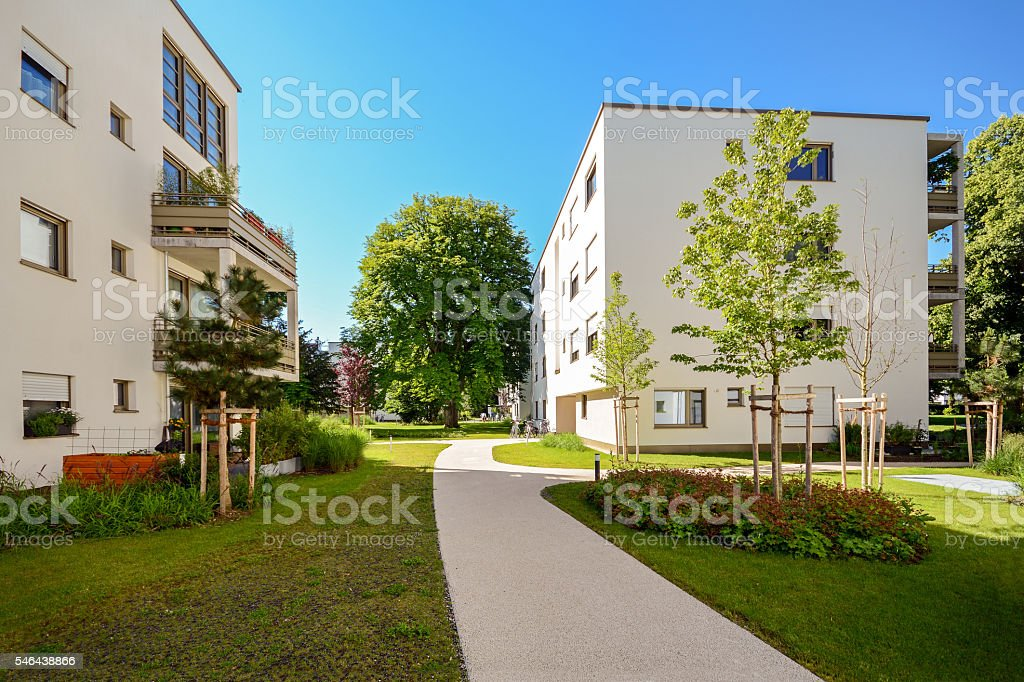 Modern residential buildings in a green environment, sustainable urban planning stock photo