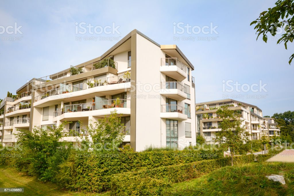 Modern residential buildings, new apartment houses with green outdoor facilities in the city stock photo