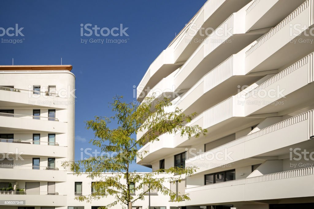 Modern residential buildings, new apartment houses with sustainable low-energy facade in the city stock photo