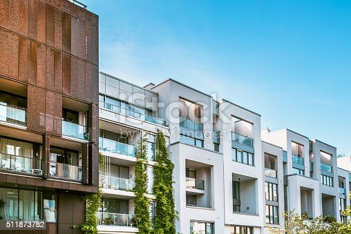 istock modern residential houses in berlin under blue sky 511873782