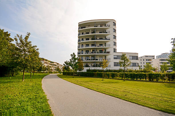 Modern residential tower, apartment building in a new urban development Modern residential tower, apartment building in a new urban development gated community stock pictures, royalty-free photos & images