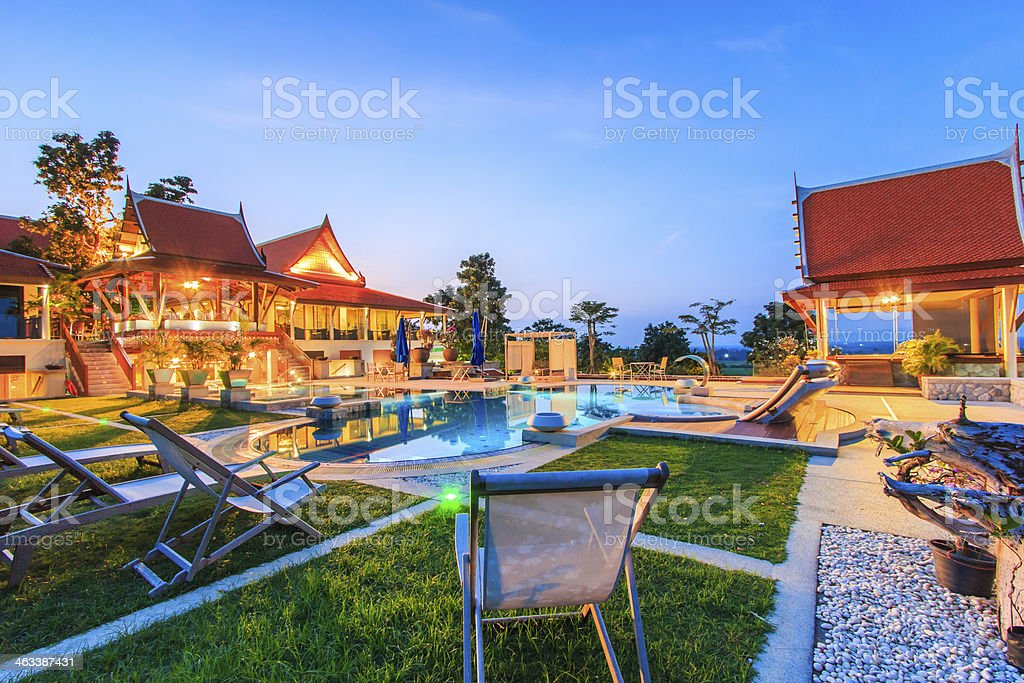 Modern resort with swimming pool at night stock photo