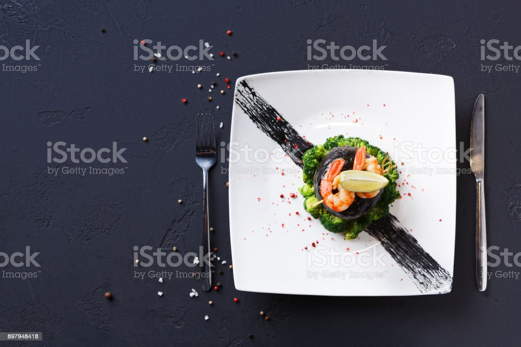 Modern restaurant food. Dorado fillet in nori with shrimps stock photo