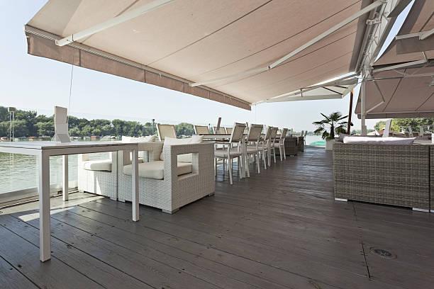 Modern riverside cafe terrace stock photo