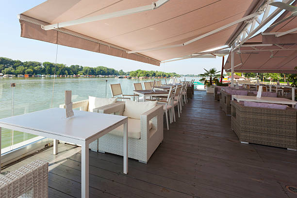 Modern riverside view of a cafe terrace stock photo