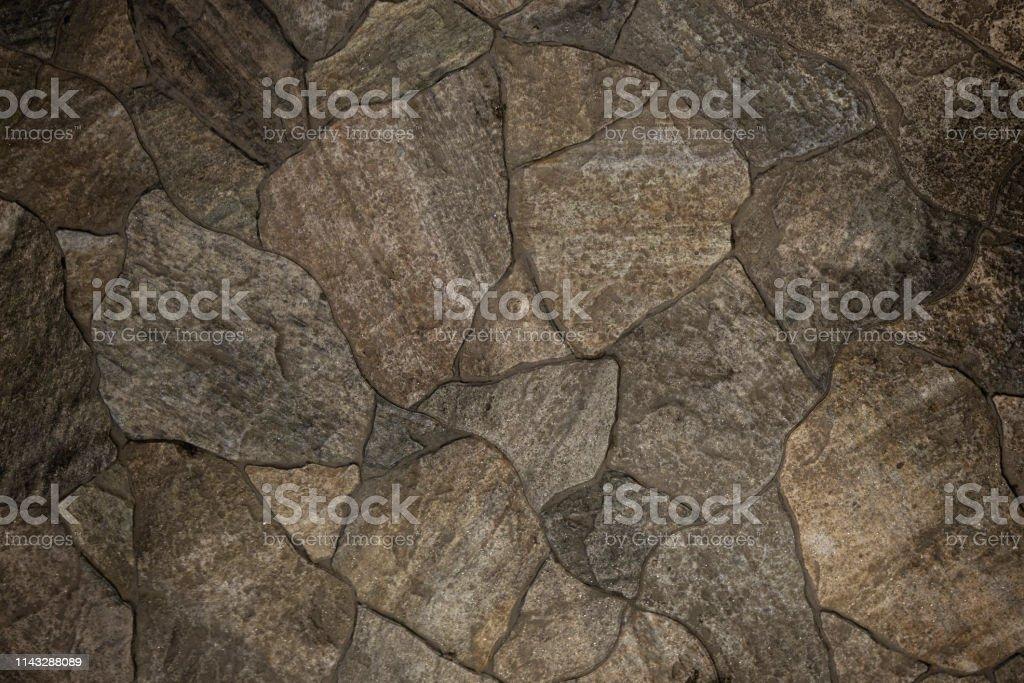 A modern rock tile floor mafe of stone texture