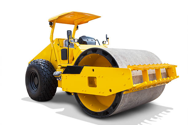 Modern roller compactor machine Image of a modern road roller with yellow color, isolated on white background compactor stock pictures, royalty-free photos & images