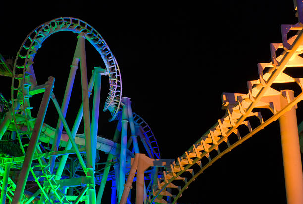 Modern Rollercoaster at night stock photo