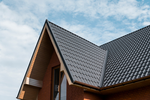 Modern Roof Covered With Tile Effect Pvc Coated Brown Metal Roof Sheets Stock Photo Download Image Now Istock