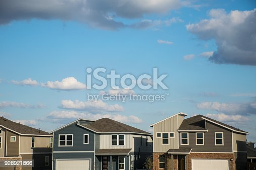istock Modern rooftops and architecture on new homes in suburbia neighborhood 926921866