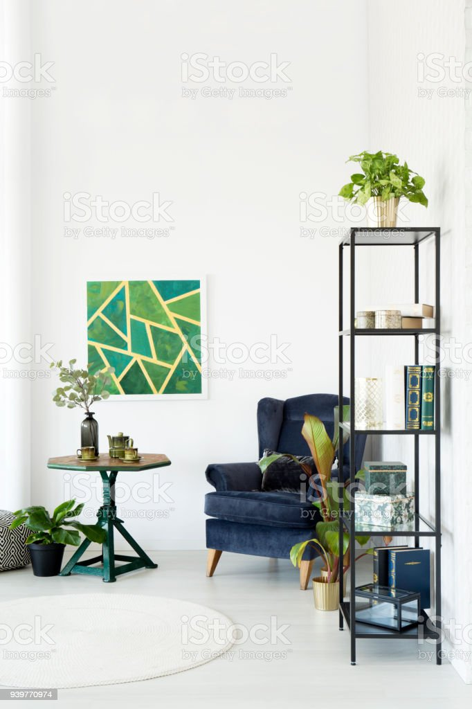 Modern room with emerald armchair stock photo