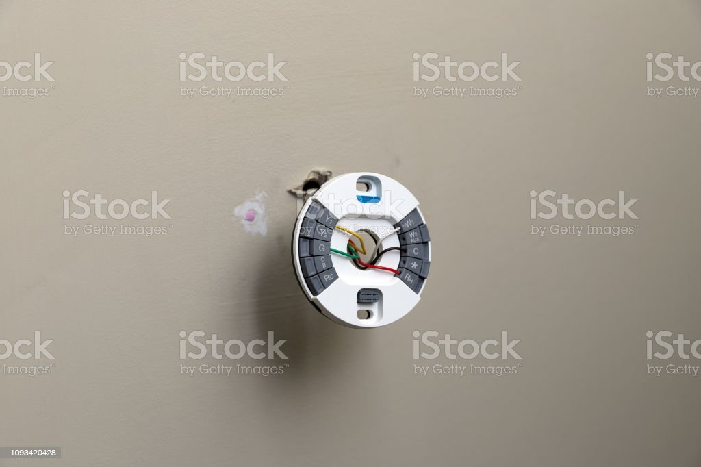 Modern round thermostat plate stock photo