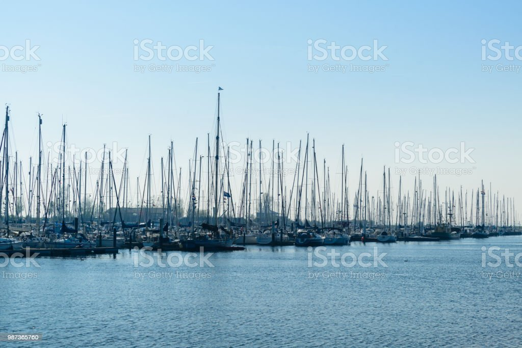 Modern Sailboats And Luxury Yachts Parked In The Seaport On