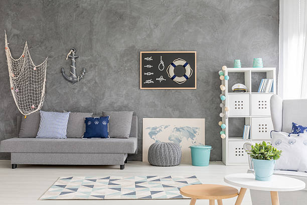 Modern sailor room with fishing net Bright room in shades of grey, with sailing decorations anchor athlete stock pictures, royalty-free photos & images