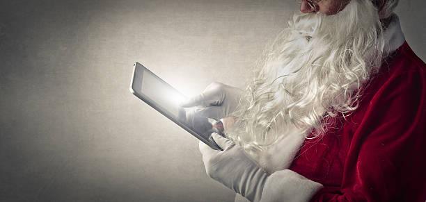 moderne santa's list - weihnachtsprogramm stock-fotos und bilder