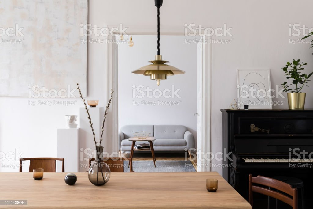 Fine Modern Scandi Interior Of Living Room With Design Wooden Table Chairs Sofa And White Stands With Stylish Accessories Abstract Paintings On The Wall Ncnpc Chair Design For Home Ncnpcorg