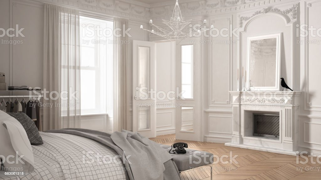 Modern scandinavian bedroom in classic vintage living room with fireplace, luxury white interior design stock photo