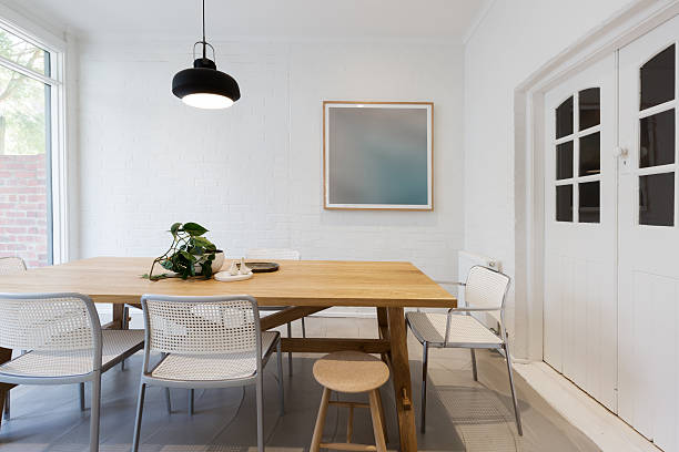 modern scandinavian styled interior dining room with pendant - schwedische möbel stock-fotos und bilder
