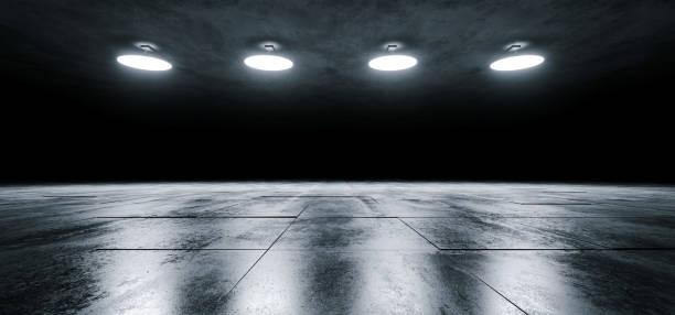 moderne sci-fi leeren bühne kuppel decke leuchtet weiß glühend auf dunklen grunge reflektierende gefliesten betontextur stock showroom bühne 3d-rendering - betonwerkstein stock-fotos und bilder