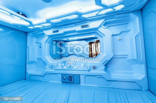 Modern sci-fi space design of a capsule hotel or hostel. It is often installed in airport terminals around the world, so that passengers can have a good rest and sleep