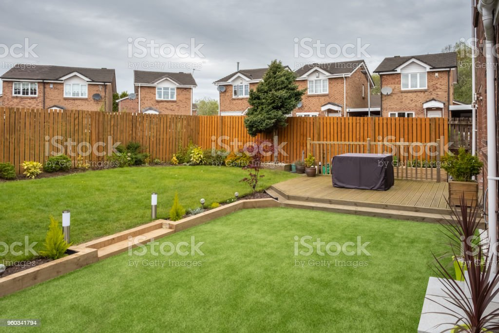 A Modern Scottish Household Garden With Plants Shrubs New Decking