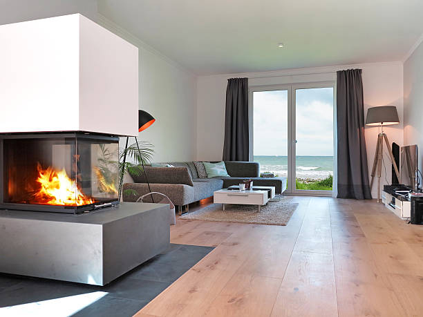 modern seaside living room with fire place stock photo