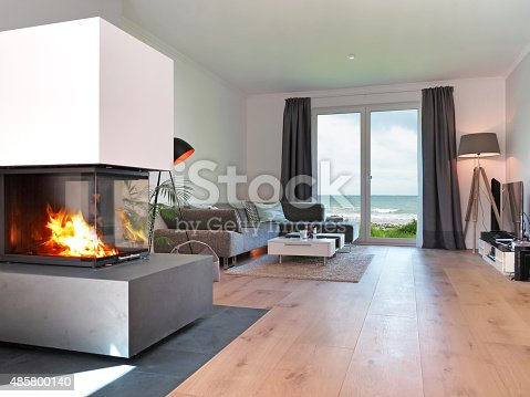 modernes strand wohnzimmer mit kamin stock fotografie und mehr bilder von 2015 istock. Black Bedroom Furniture Sets. Home Design Ideas