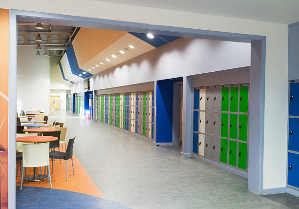 Modern secondary school Interior area with seating and lockers near the entrance of a modern secondary school. high school building stock pictures, royalty-free photos & images