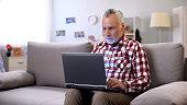 Modern senior freelancer working remotely at home, business online in internet