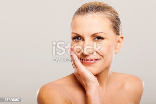 istock modern senior woman with hand on her face 178726087