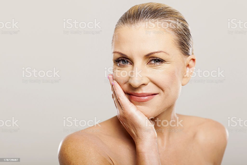 modern senior woman with hand on her face stock photo
