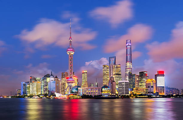 Modern Shanghai Skyline Twilight shot with the Shanghai skyline along the Huangpu river, China shanghai stock pictures, royalty-free photos & images
