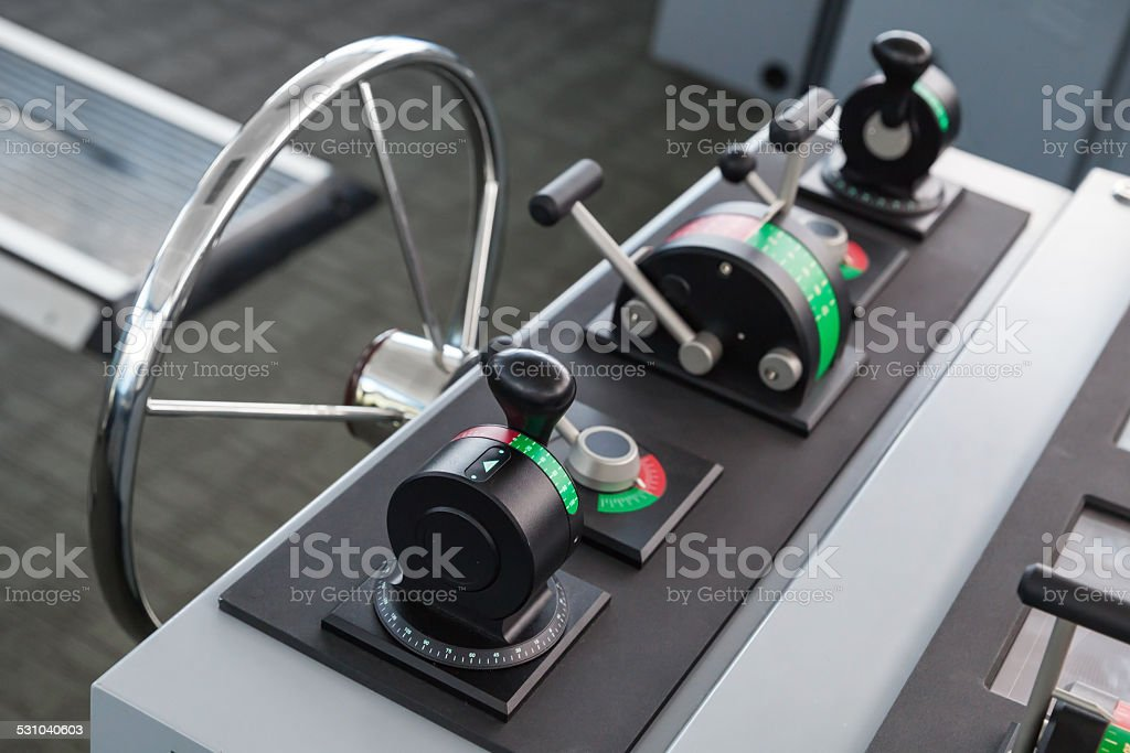 Modern ship control panel with steering wheel stock photo