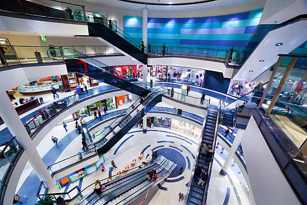 modern shopping mall interior - shopping mall stock photos and pictures