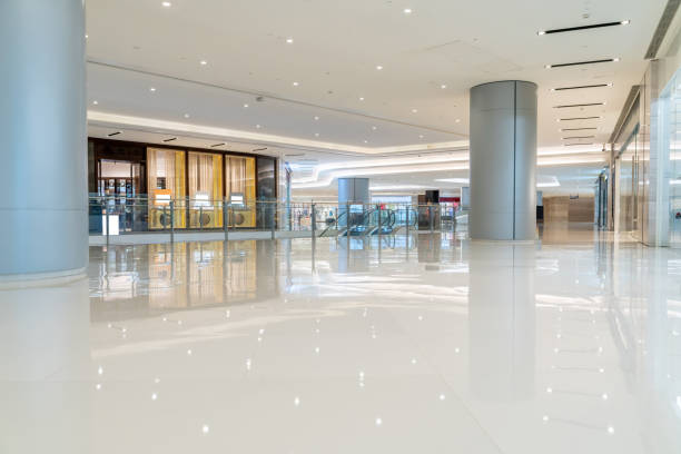 modern shopping mall interior with shopfront and corridor. modern shopping mall interior with shopfront and corridor. shopping mall stock pictures, royalty-free photos & images