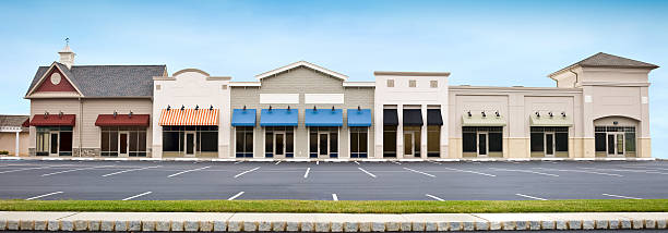 Modern Shopping Plaza Store Front Panoramic with Empty Parking Lot stock photo