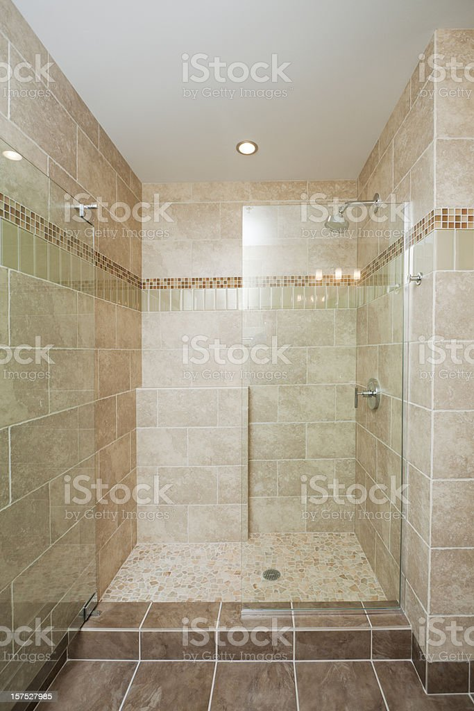 Modern Shower in Domestic Bathroom, with Glass Door, Marble Tile royalty-free stock photo