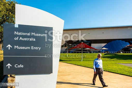 istock Modern signpost with directional arrow to the iconic National Museum of Australia 1176295076