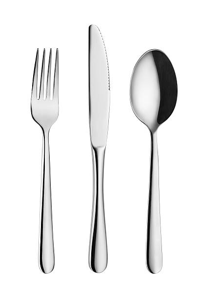 Modern silverware or flatware set isolated on white. stock photo