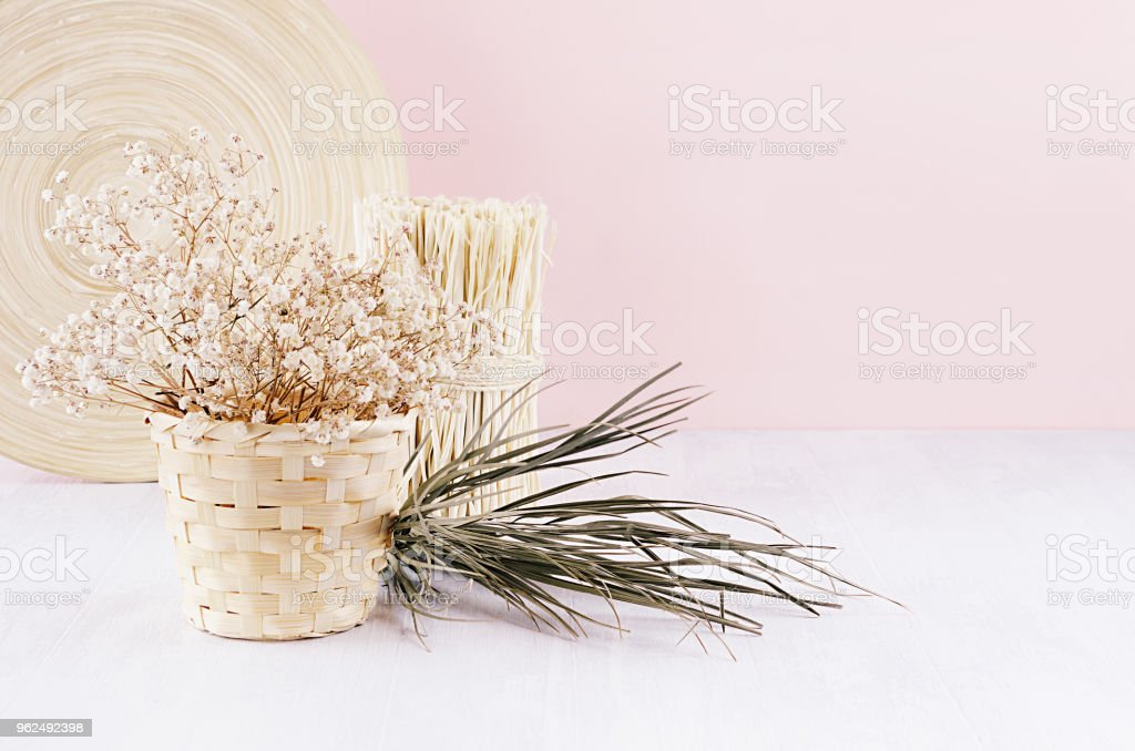 Modern simple art pink home decor with natural beige wood home decoration and dry flowers on soft light wooden table. - Royalty-free Affectionate Stock Photo