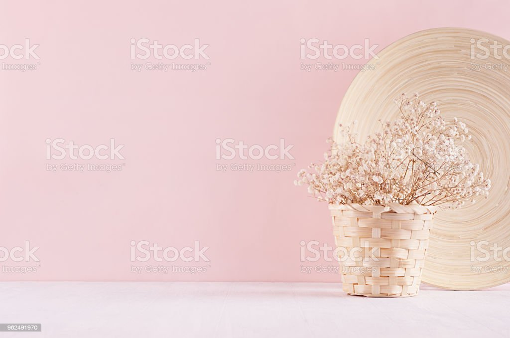 Modern simple art pink home decor with white dried flowers, bamboo dish on soft light white wood table. - Royalty-free Affectionate Stock Photo