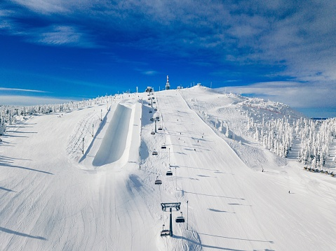 Modern ski chair-lift in Finland Lapland ski resort. Aerial view from above.
