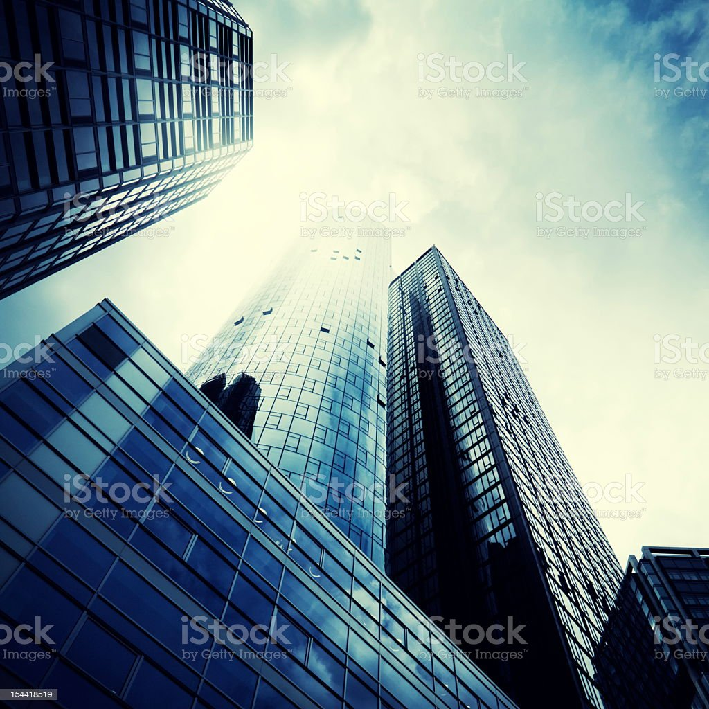 Modern skyscrapers against a dramatic sky royalty-free stock photo