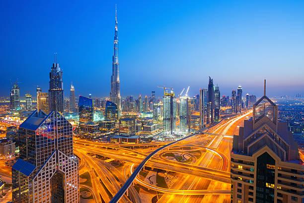 modern skyscrapers, busy evening highways in luxury dubai city,uae - abu dhabi стоковые фото и изображения