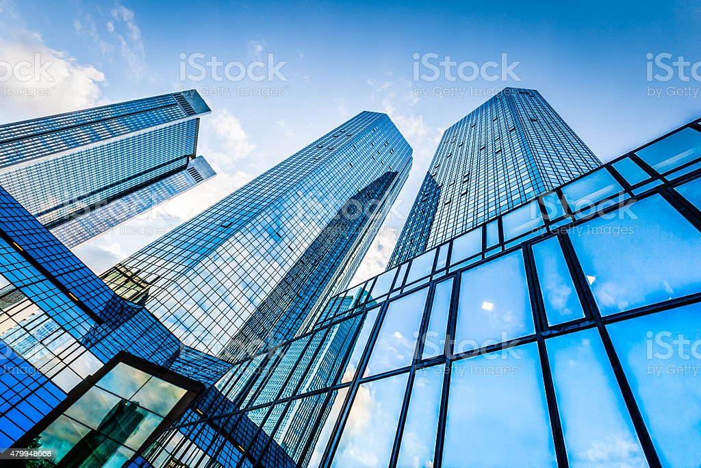 Modern skyscrapers in business district against blue sky stock photo